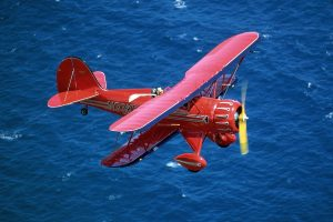 Red Plane Fly Above Sea