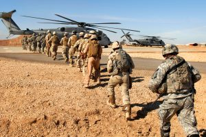 Soldiers Going To Helicopter