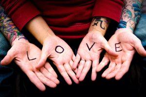 Stunning HD Photo of Love Word in Hand