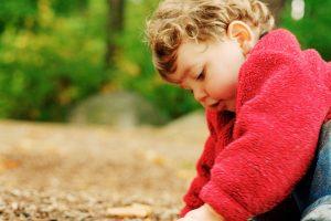 Cute Baby Boy Playing in Garden