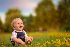 Smiling Beautiful Baby in Garden Photo