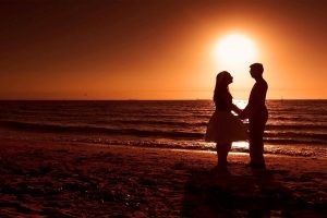 Romantic Couple on Beach during Sunset