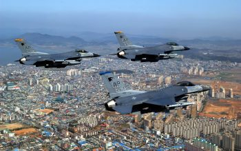 F Fighting Falcons Over City